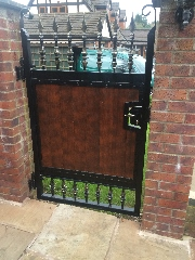 Wrought iron metal and timber gate